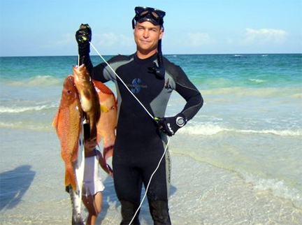 Mike with Fish that have been speared